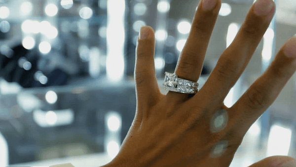 diamond ring on woman's hand