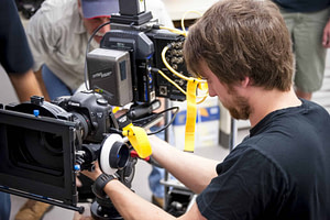 man working on a video camer