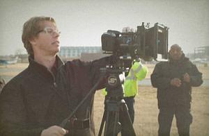 man videotaping outdoors