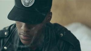 man in a black cap