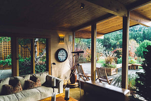 rustic room with lots of windows